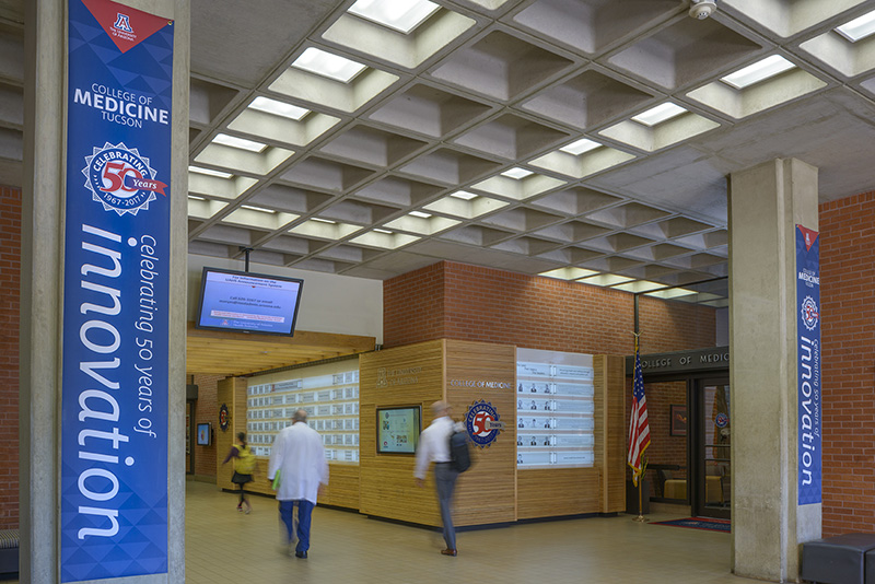 Lobby featuring banners, 3-D signage, touchscreen graphics